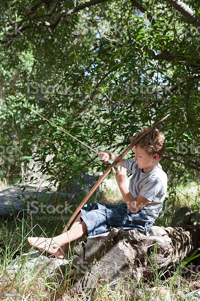 Boy with bow and arrow royalty-free stock photo