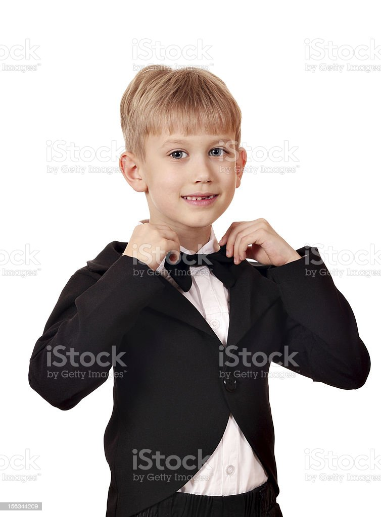 boy with bow tie and black tuxedo suit royalty-free stock photo