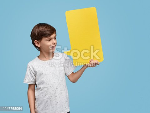 465462550istockphoto Boy with bright yellow message box 1147768064