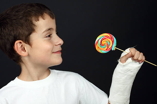 Boy with broken hand stock photo
