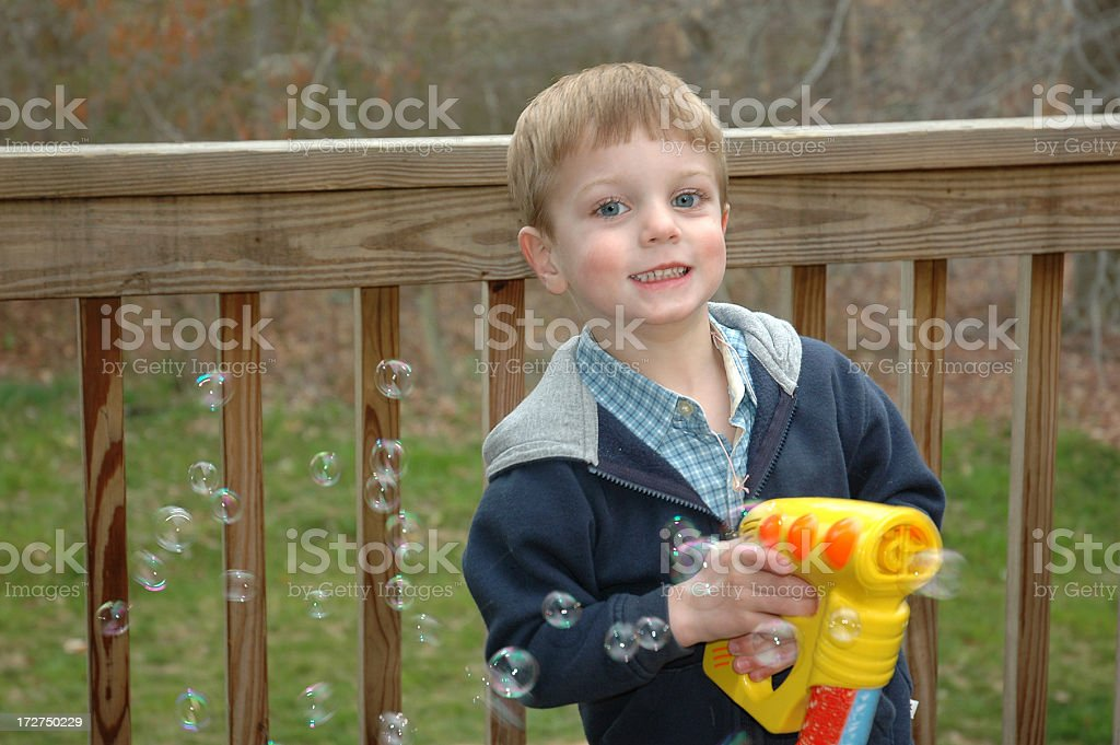 Boy with Bubble Gun stock photo