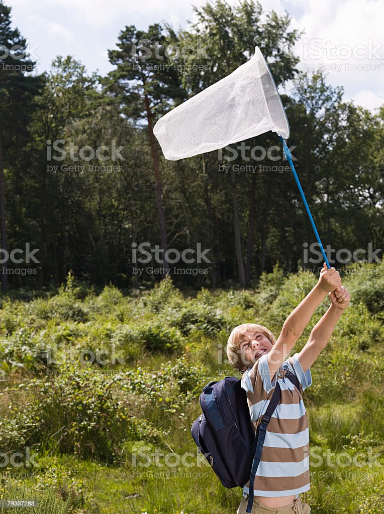 Boy with butterfly net 免版稅 stock photo