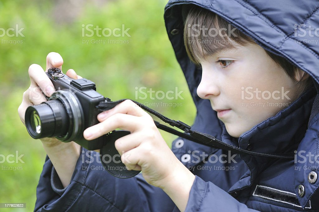 Boy with camera on nature royalty-free stock photo