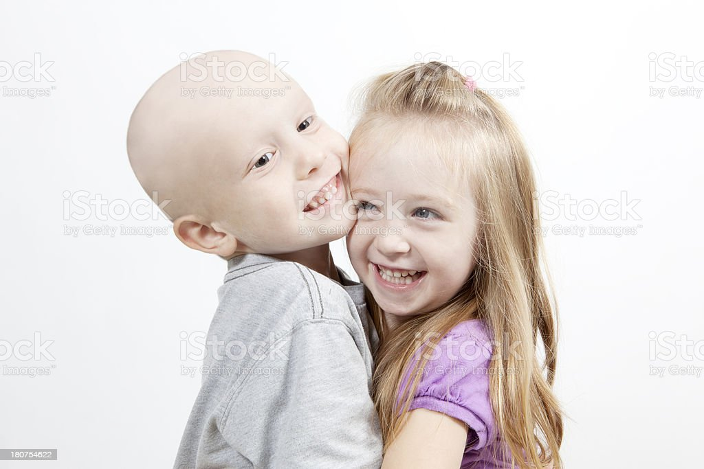 Boy with Cancer and Sister Laughing stock photo