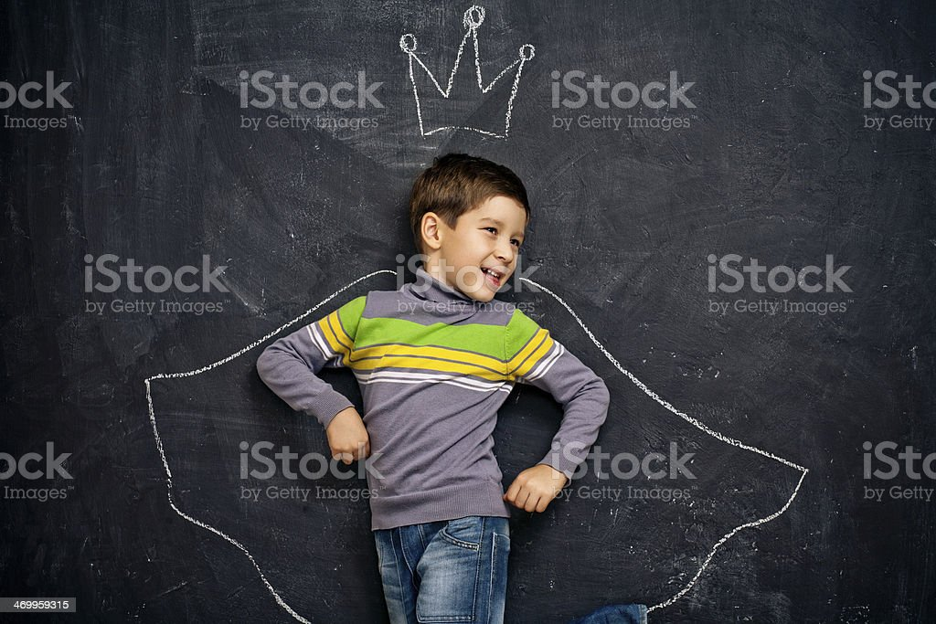 Boy with chalk crown and cloak drawn around him royalty-free stock photo