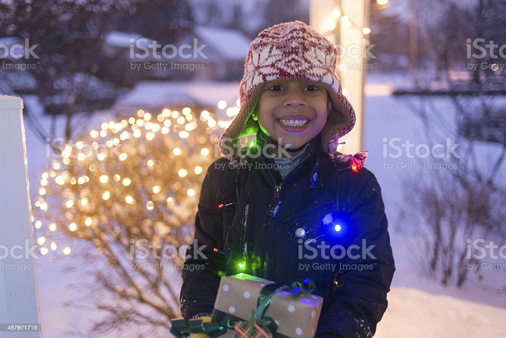 Boy with Christmas Lights stock photo