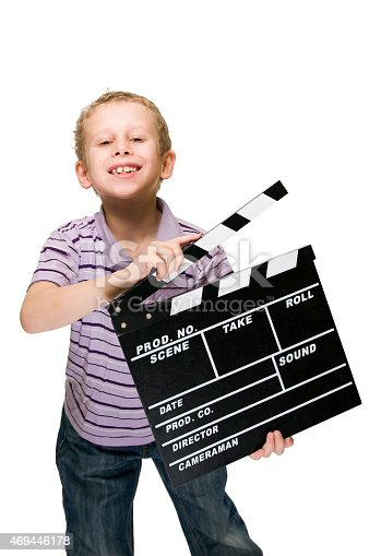 istock boy with clapperboard grinning 469446178