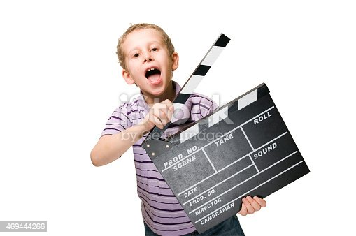 istock boy with clapperboard upper part 469444266