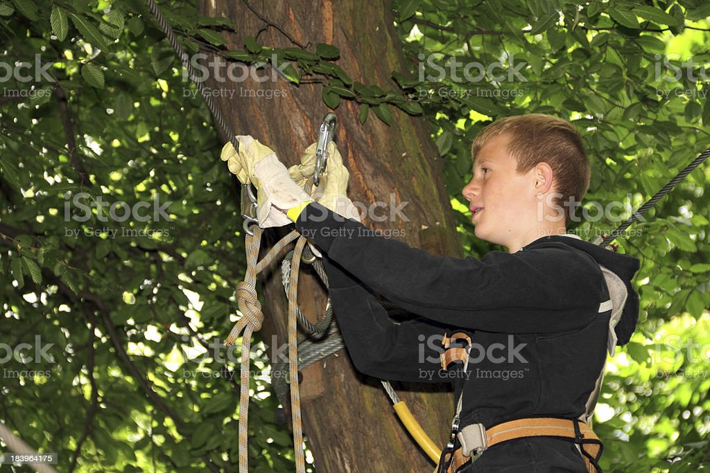 boy with climbing kit stock photo