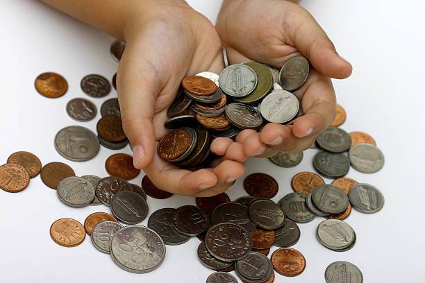 Boy with coins stock photo