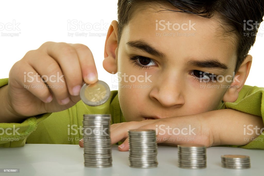 Boy with coins royalty-free stock photo