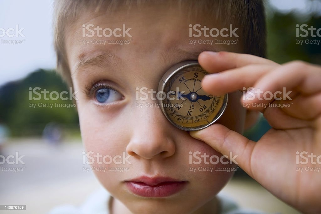 Boy with compass stock photo