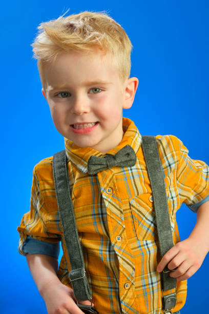 Boy with curious attitude in studio stock photo