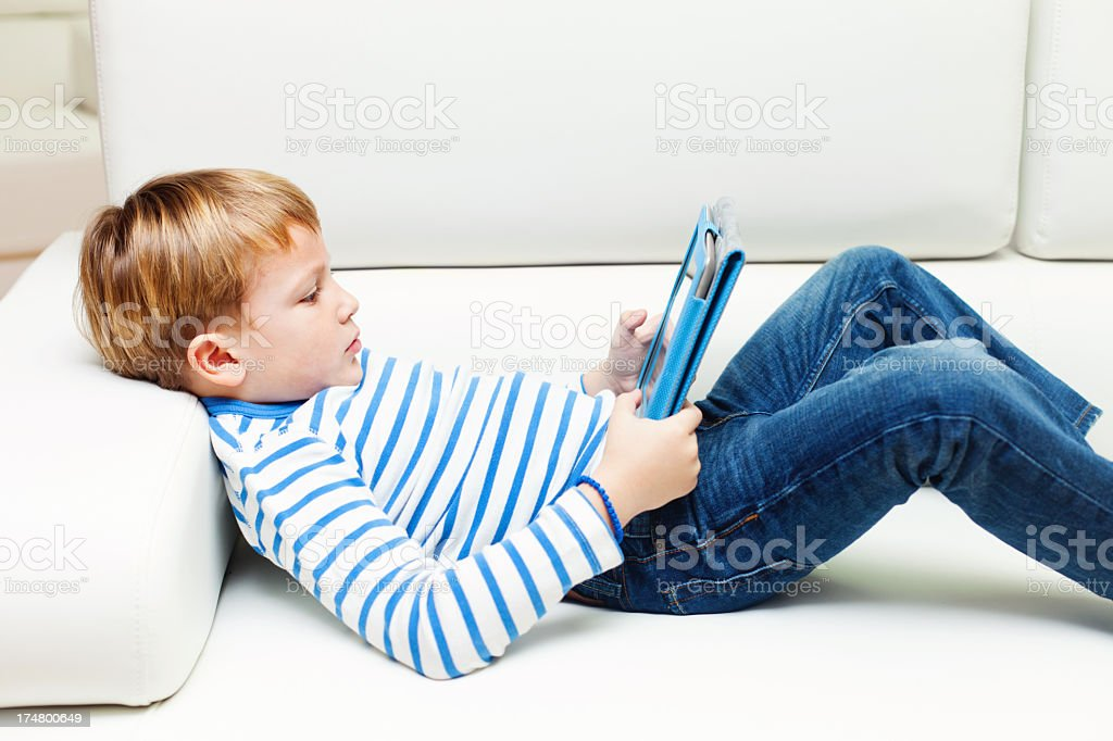 Boy with digital tablet. royalty-free stock photo