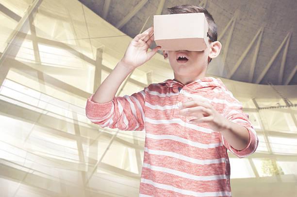 boy with diy virtual reality cardboard headset - do it yourself videos stock-fotos und bilder