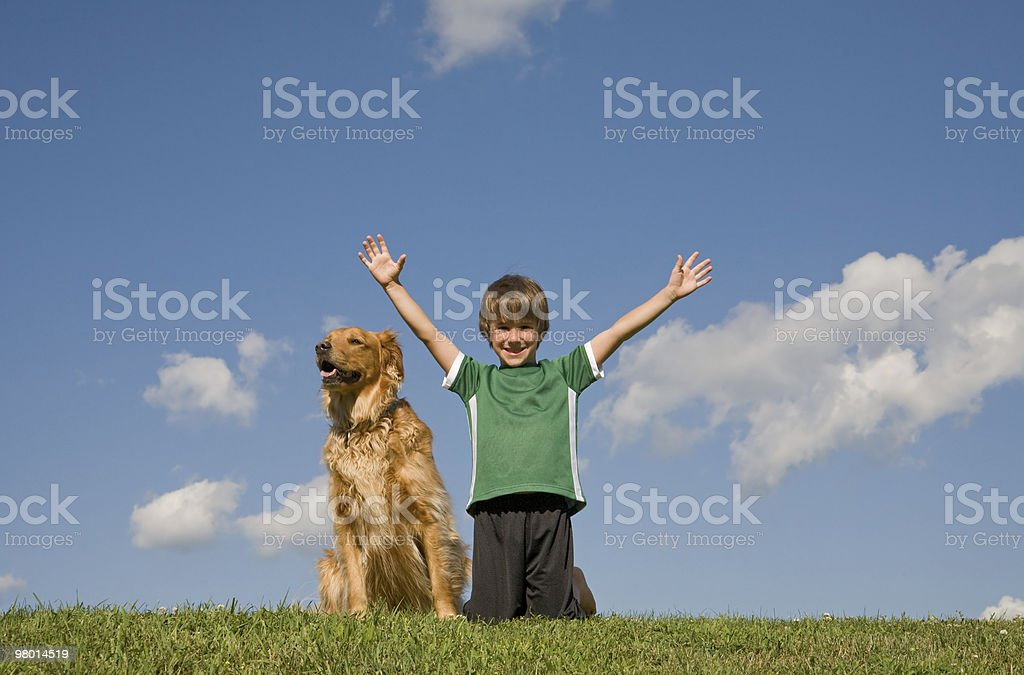 Boy With Dog in the Sky royalty-free stock photo