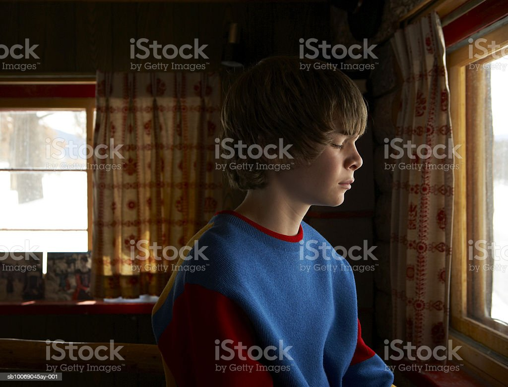 Boy (13-14) with eyes closed royalty-free stock photo