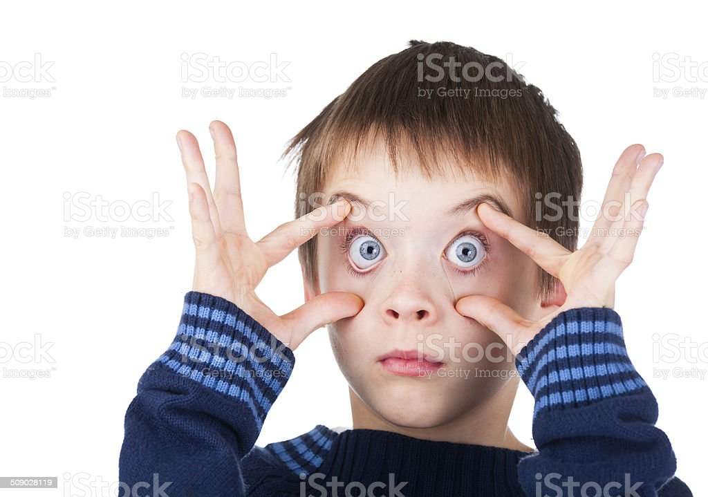 Boy with eyes wide open stock photo