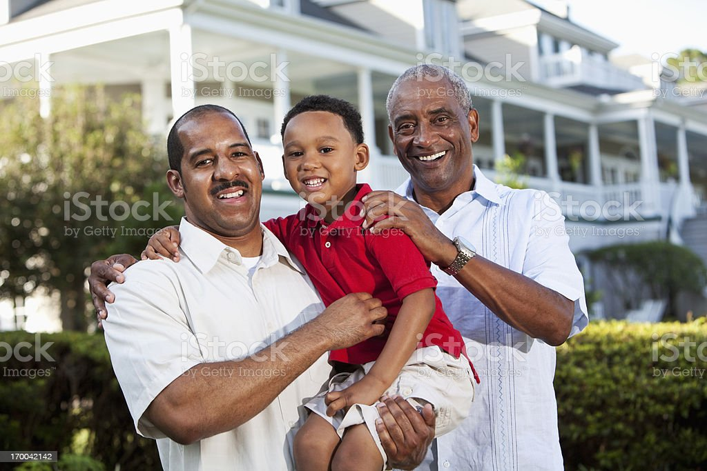 Boy with father and grandfather royalty-free stock photo