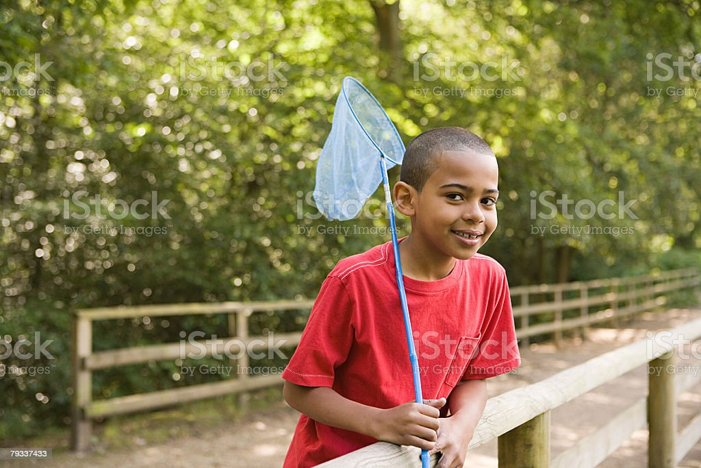 Boy with fishing net royalty-free stock photo