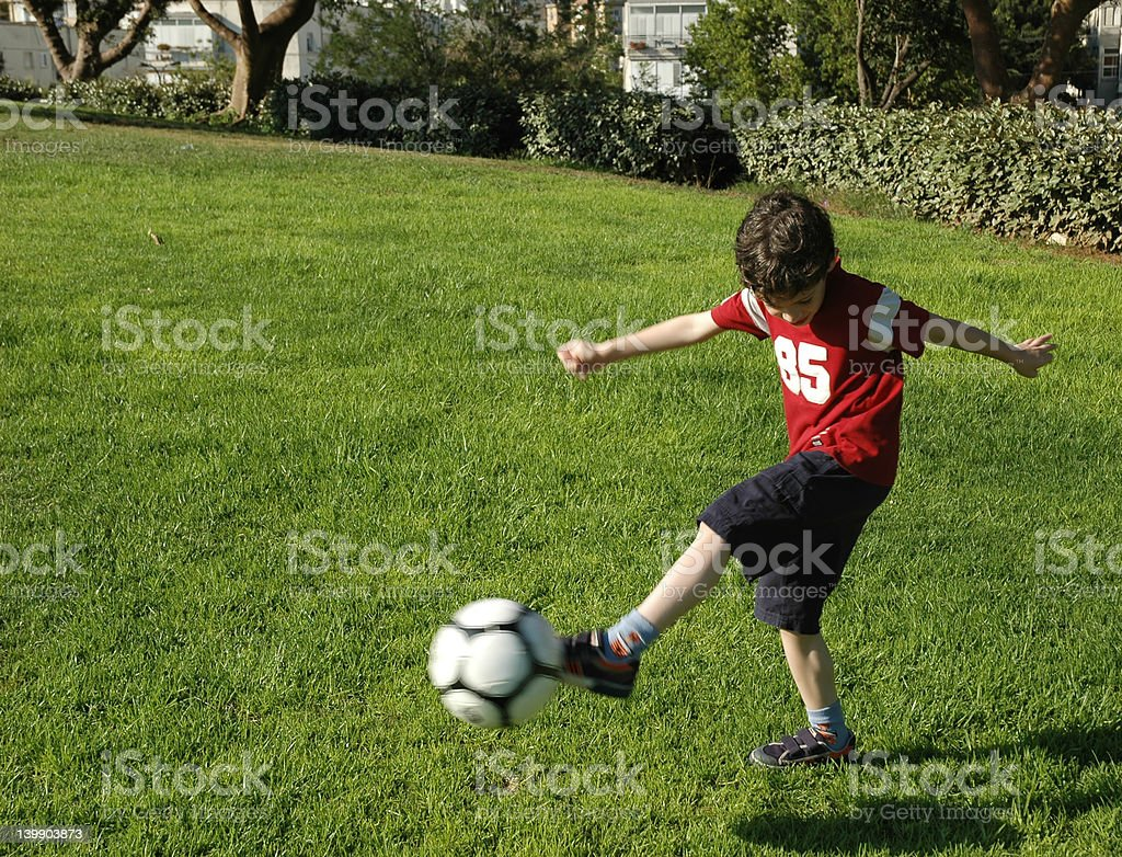 Boy with football stock photo