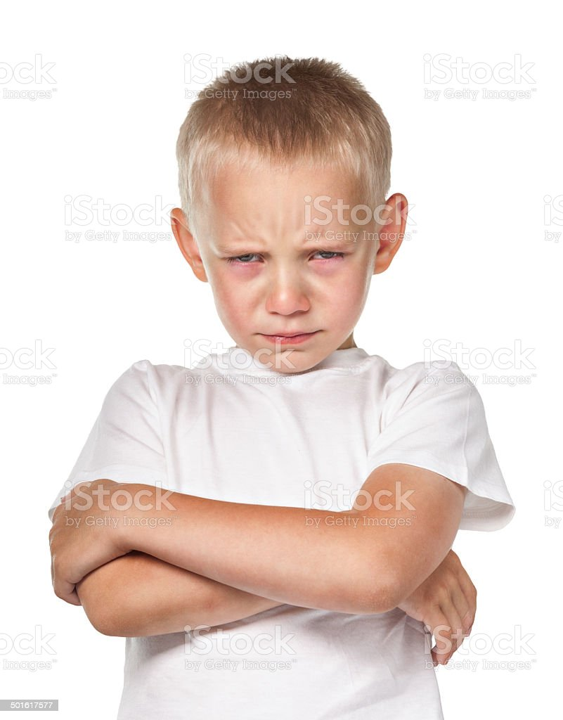 Boy with frowning face stock photo