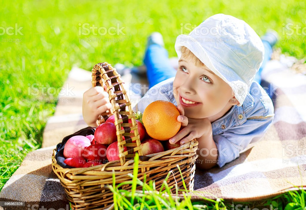 boy with fruit outdoor royalty-free stock photo