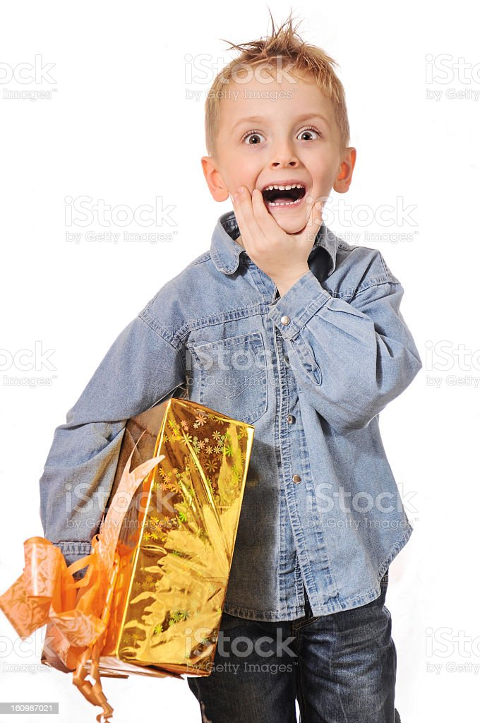 Boy with gift box. royalty-free stock photo