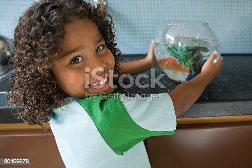 109350576 istock photo Boy with goldfish 80469678