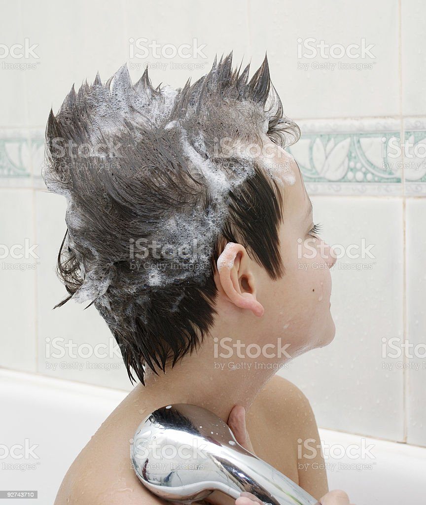 Boy with hair in soap at bathtub royalty-free stock photo