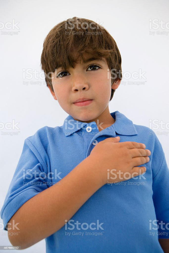 Boy with Hand Over Heart stock photo