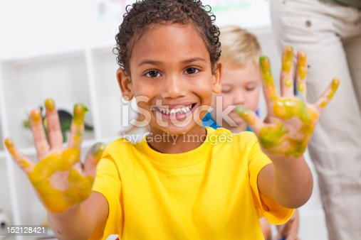 154371635 istock photo boy with hand paint 152128421