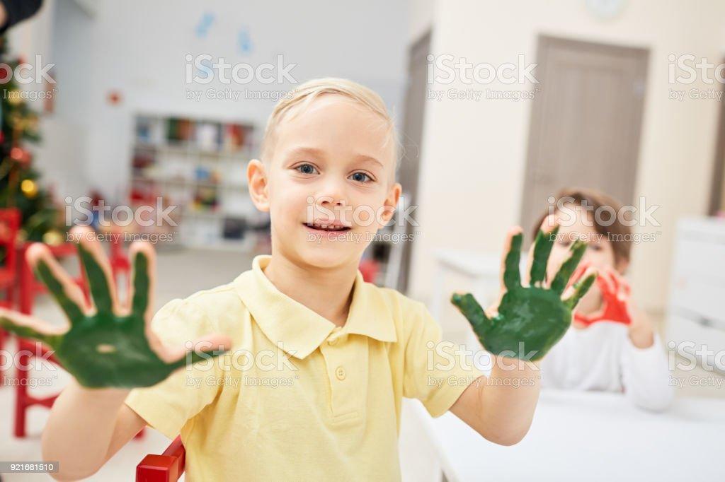 Boy with handpaint stock photo