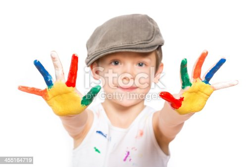 istock boy with hands in paint on white 455164719