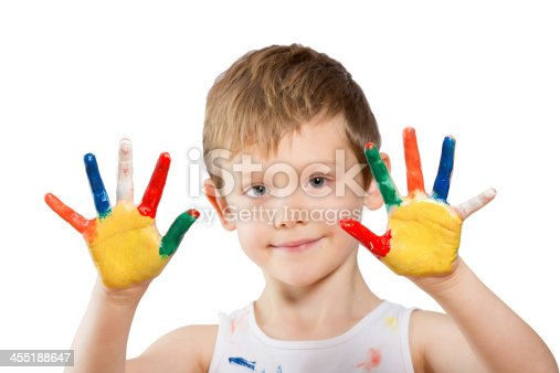 istock boy with hands in paint on white 455188647
