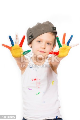 istock boy with hands in paint on white 455188699