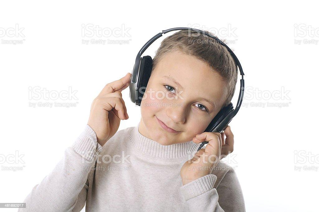 Boy with headphones smilling stock photo