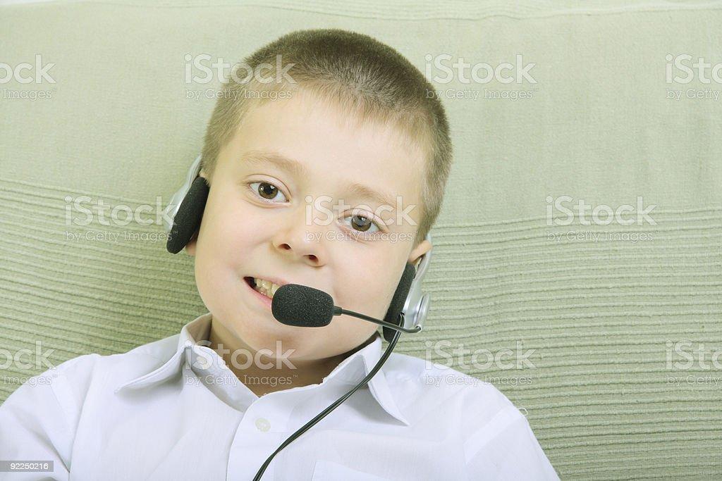 Boy with headset phone stock photo