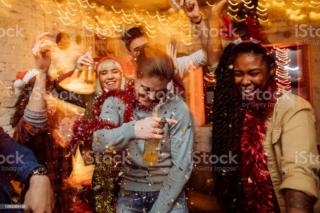 Six friends having a good time and dancing at the Christmas party