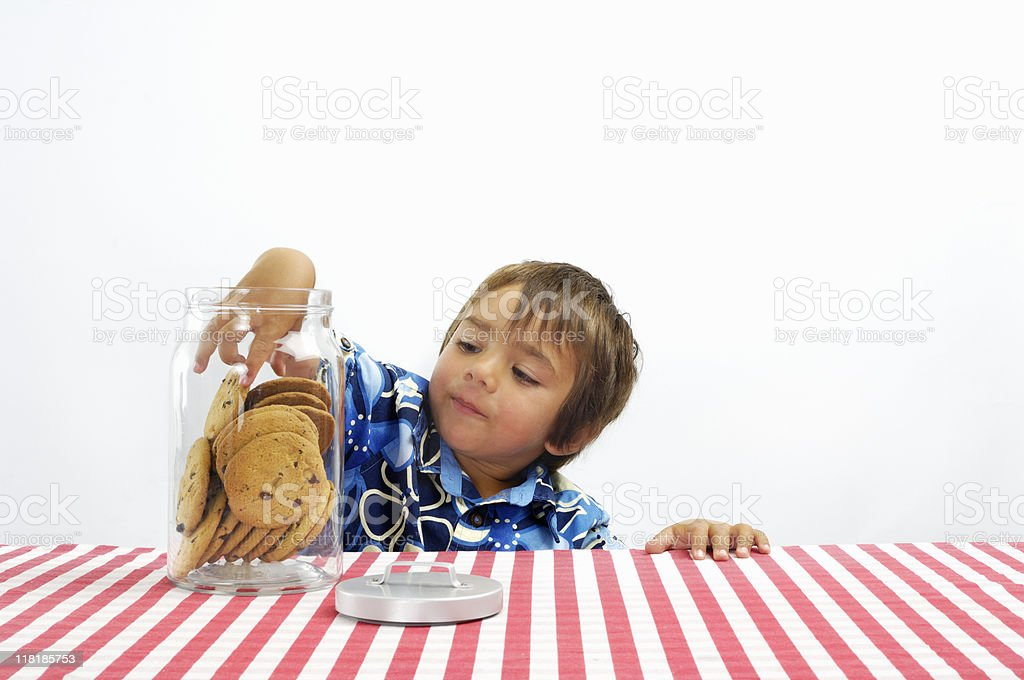 Boy with his hand in the cookie jar royalty-free stock photo