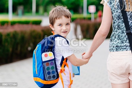 istock Boy with his mother at road to school. 596772164