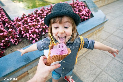 Happy little boy with ice cream.