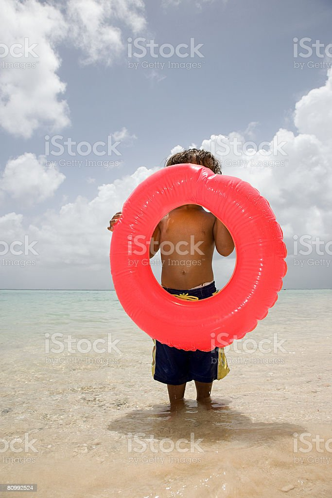 Boy with inflatable ring royalty-free stock photo
