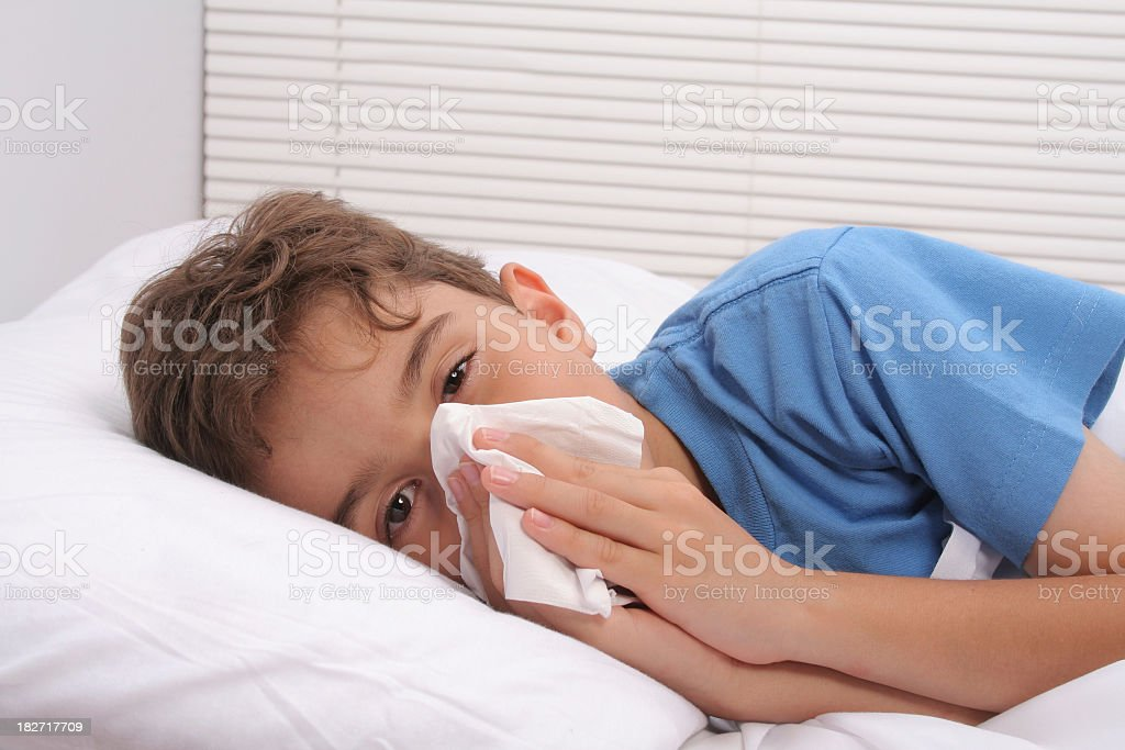 Boy with influenza stock photo