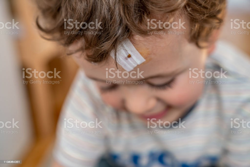 Boy with injury on head