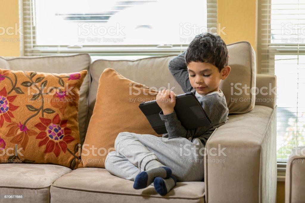 Boy with iPad stock photo