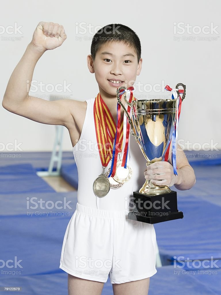 Boy with medals and trophy 免版稅 stock photo