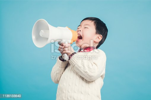 istock Boy with megaphone making an announcement 1135133540