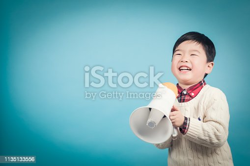 istock Boy with megaphone making an announcement 1135133556