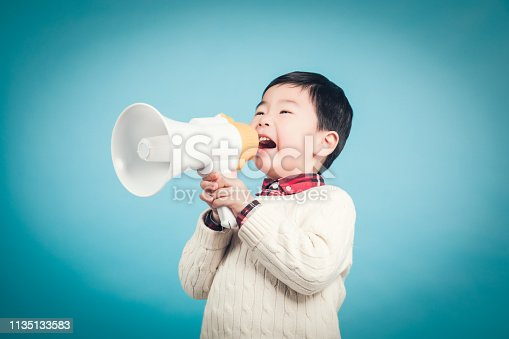 istock Boy with megaphone making an announcement 1135133583